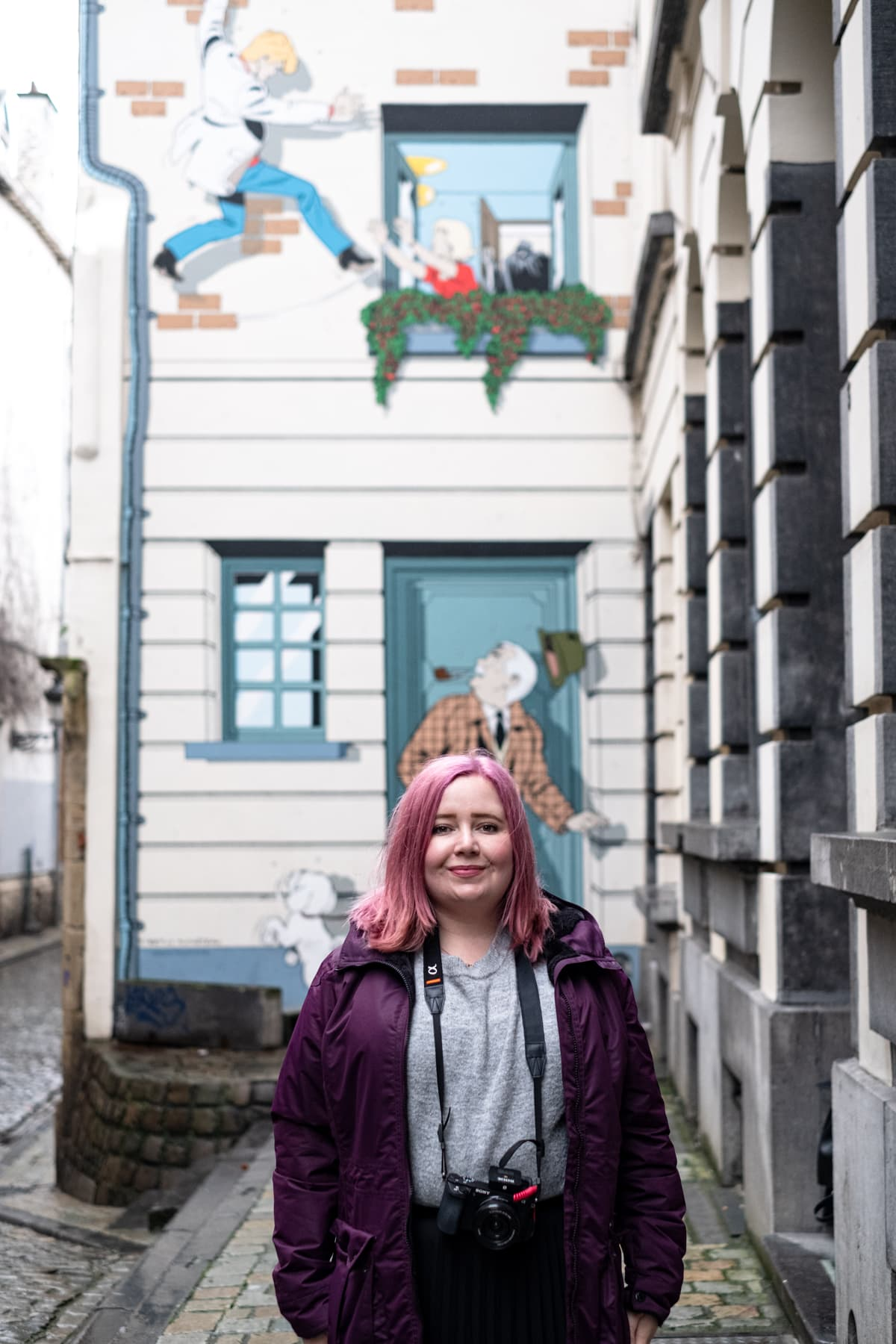 Kat next to Comic Book Strip in Brussels