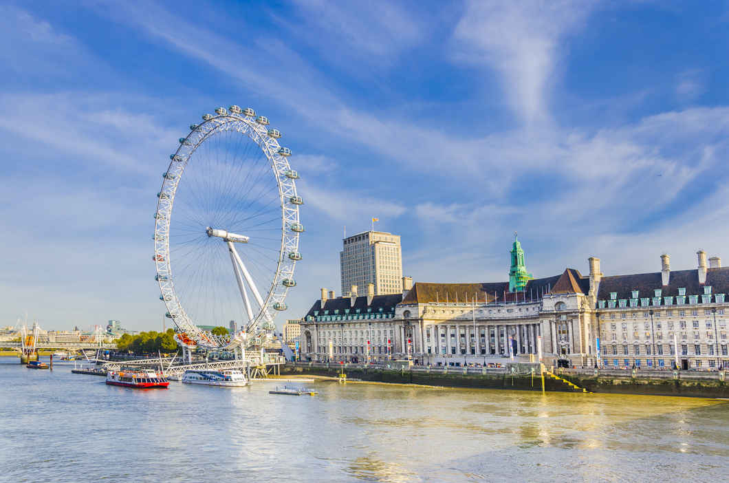 View of the London Eye from the river Thames.