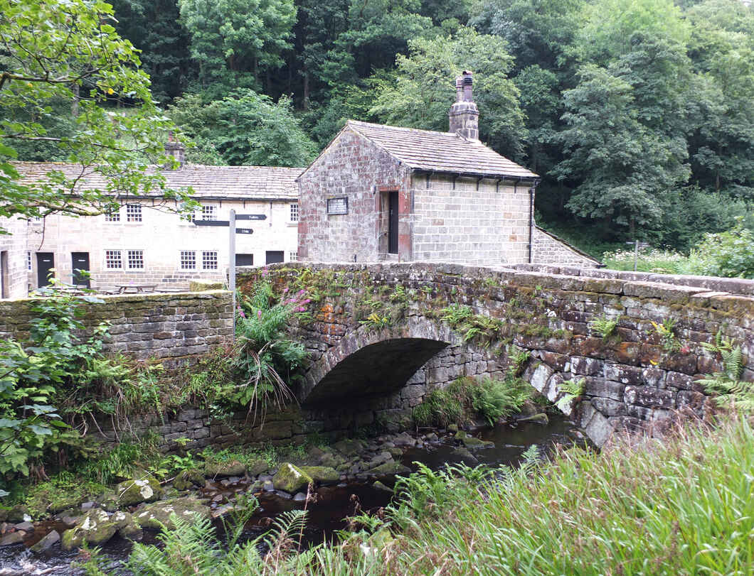 Gibson mill in Hardcastle Crags West Yorkshire with river and woodland.