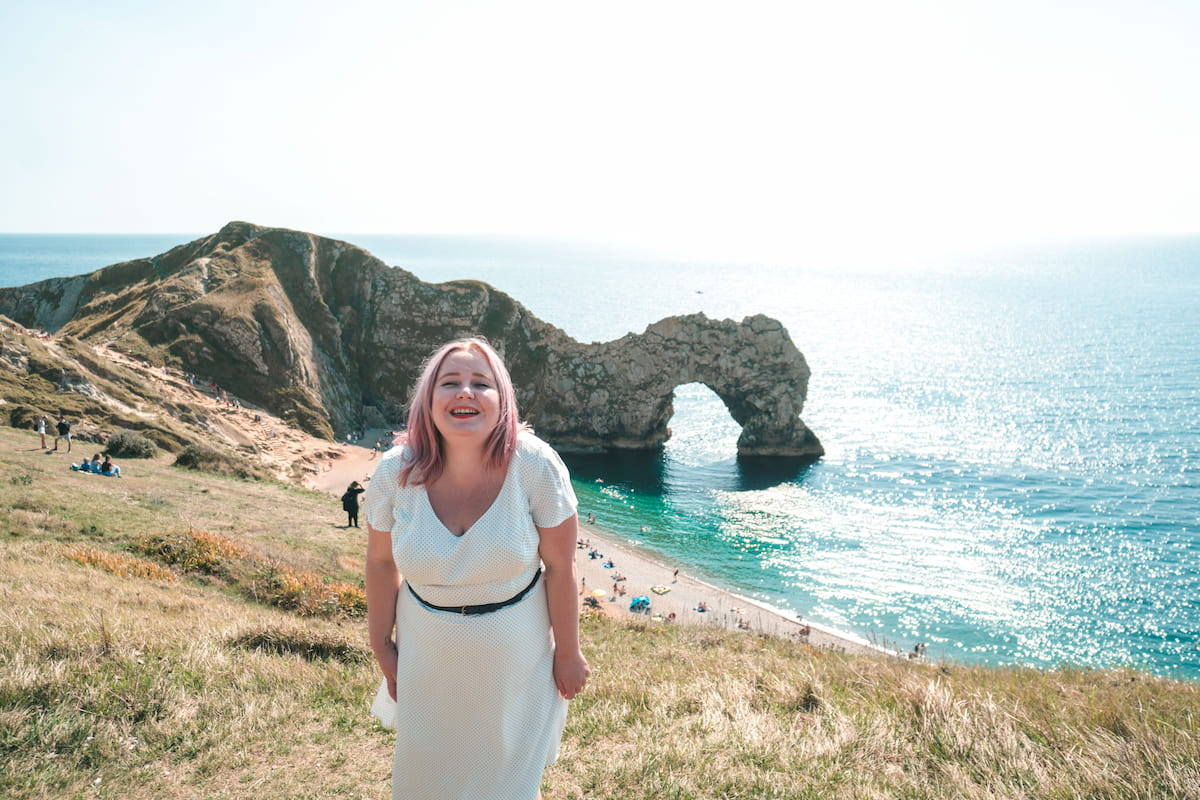Kat in a white dress at Durdle Door