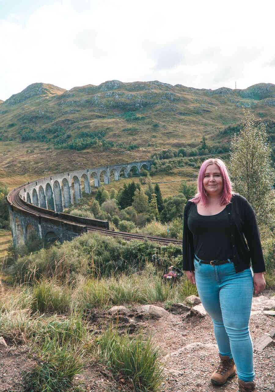 Kat in her hiking boots at Glenfinnan Viaduct Scotland