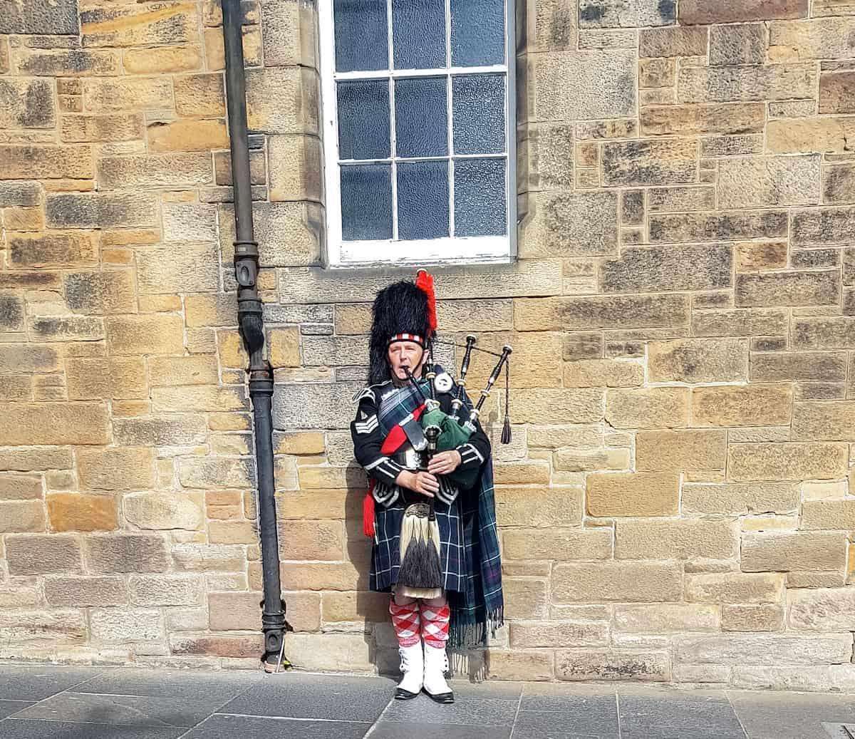 Scottish man playing bag pipes
