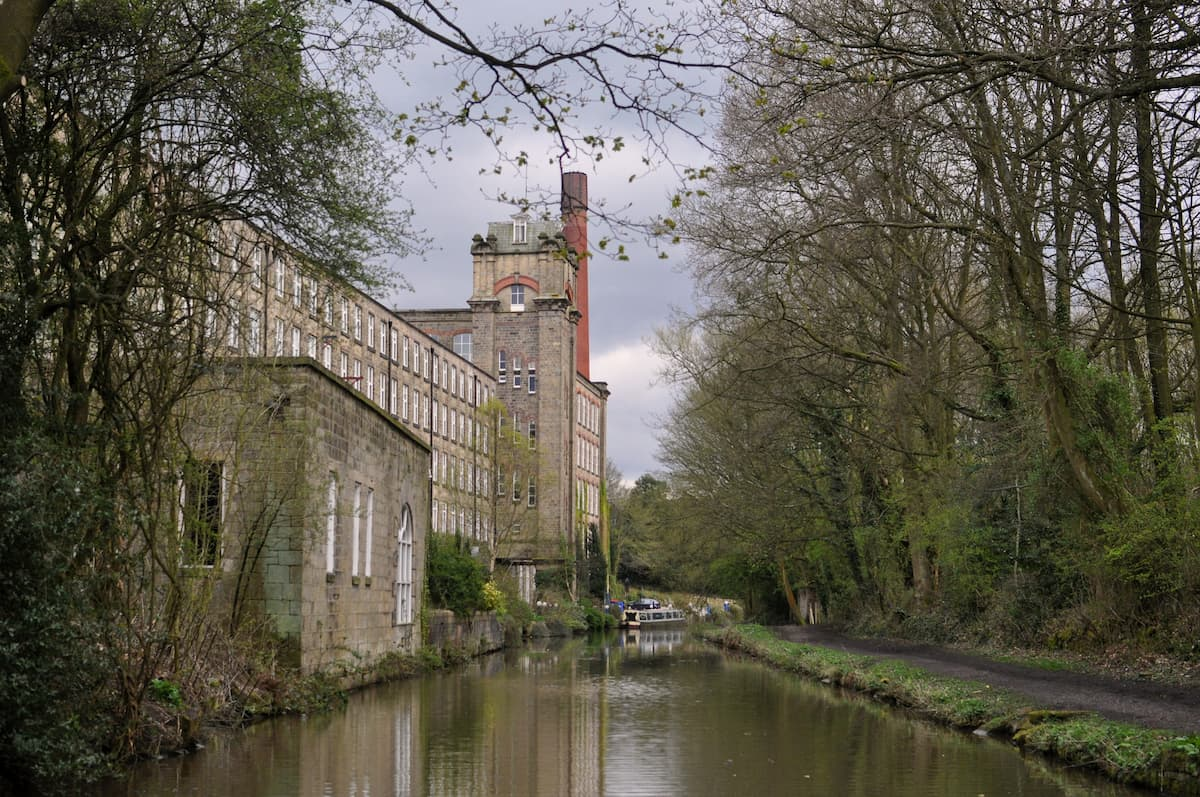 An old factory on the banks of the canal near Bollington in Cheshire