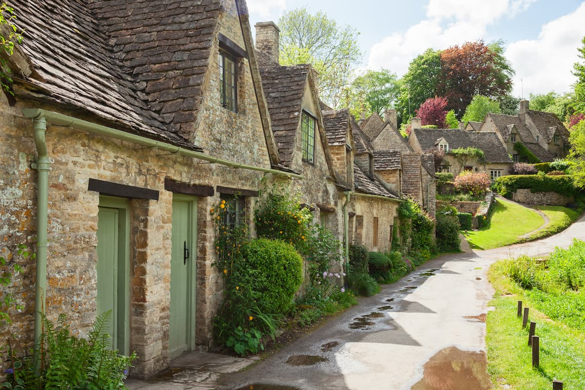 Old street with traditional cottages in beautiful spring day , Bibury