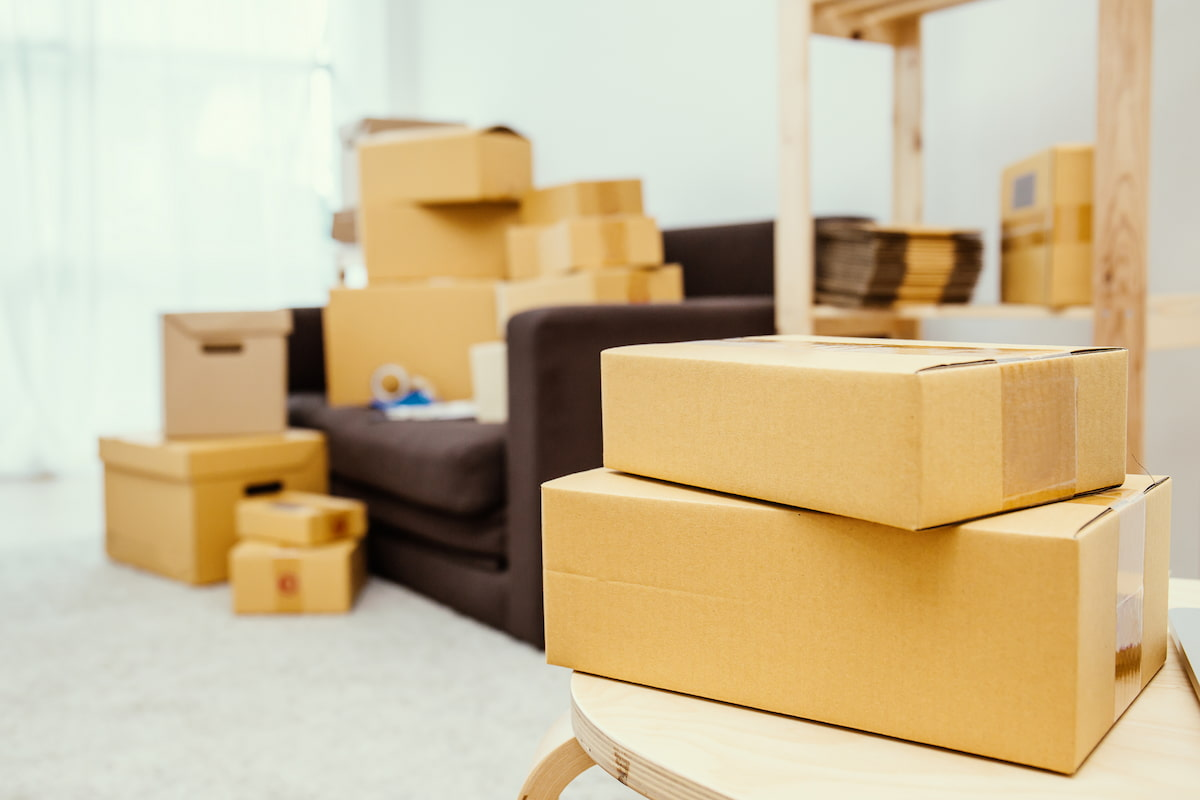 Packed boxes with a sofa