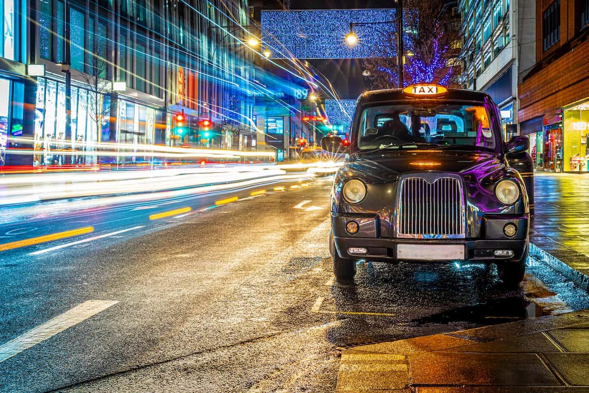 Black cab in Christmas traffic on Oxford street, London