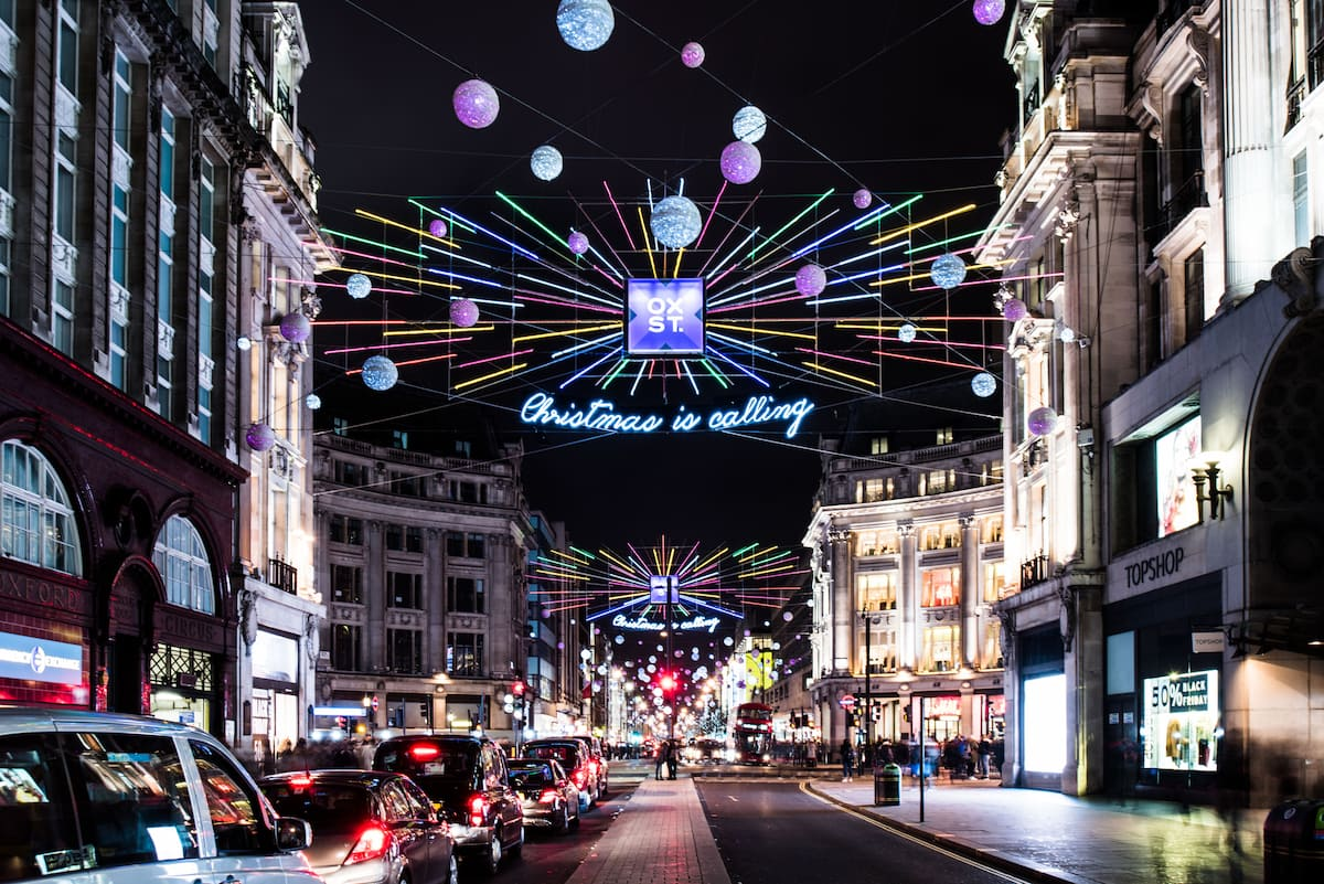 Christmas lights in London Oxford street with cars in traffic