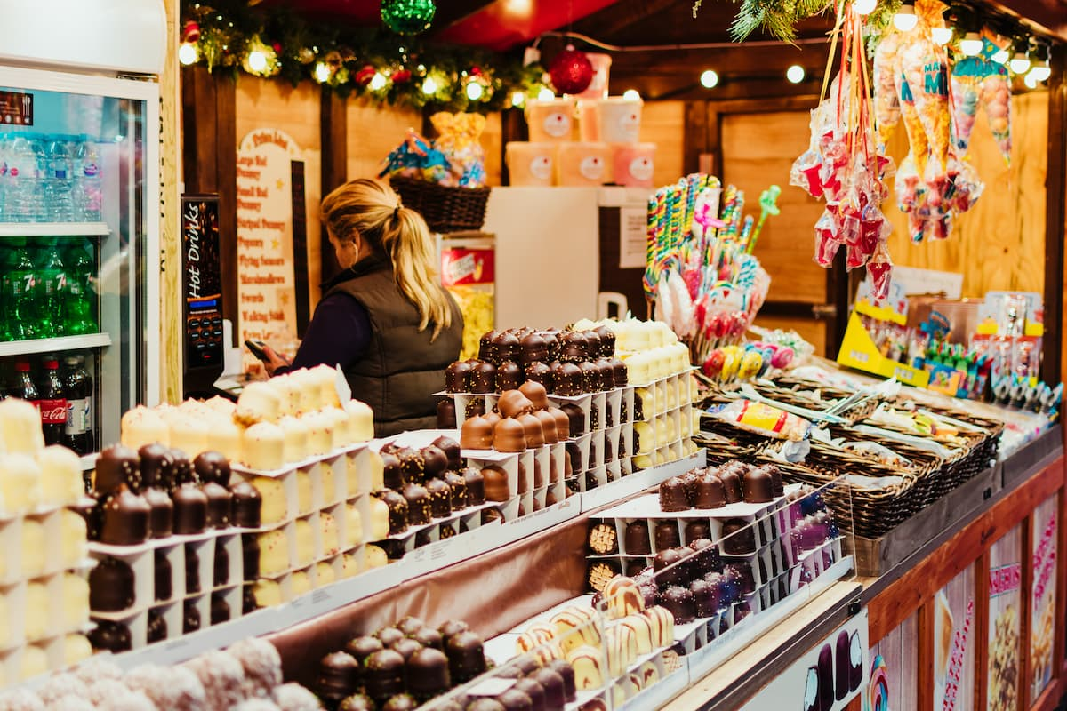 Christmas stall with chocolates, candy and sweets at the Christmas market of Leicester