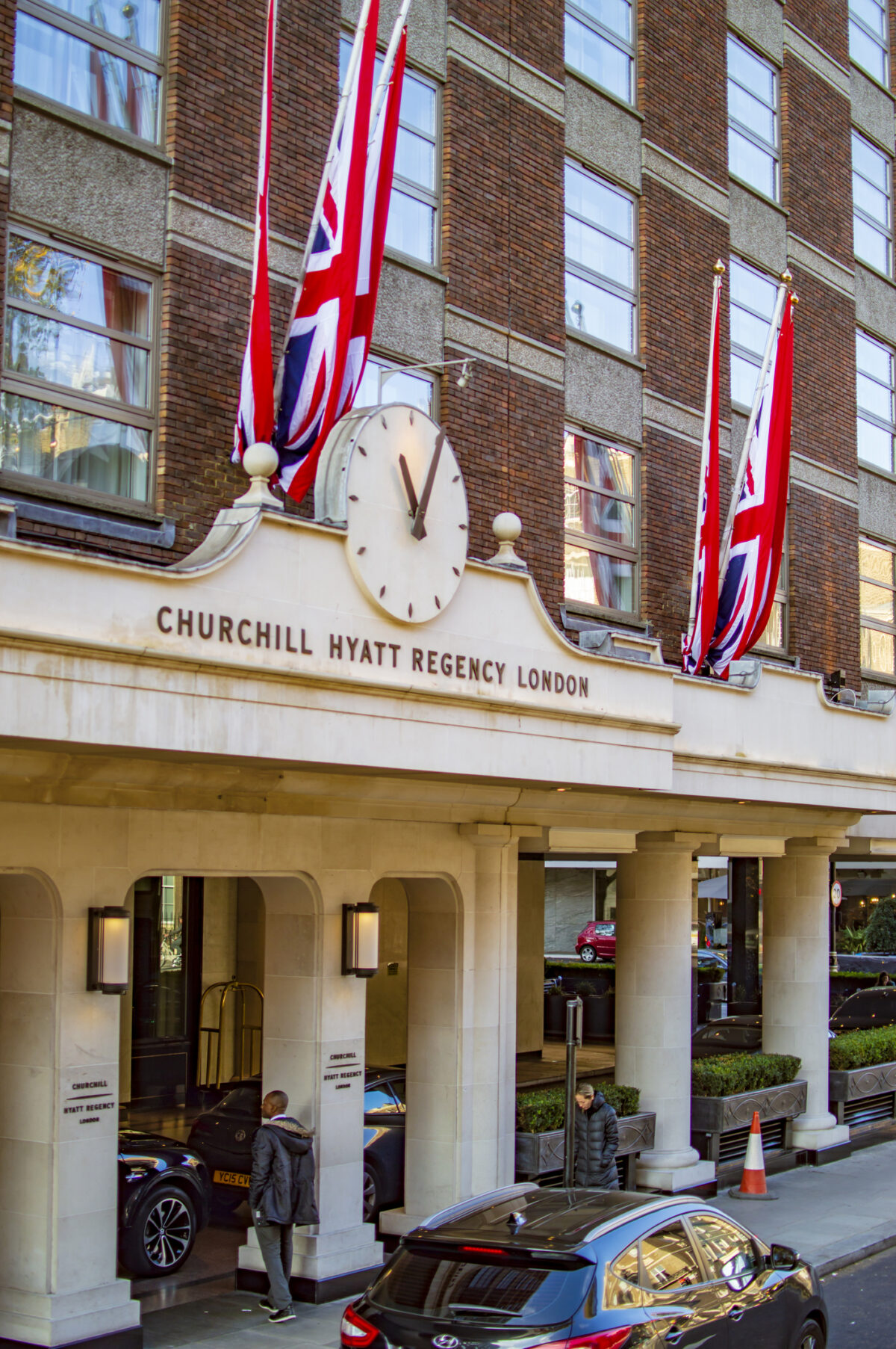 Churchil Hyatt Regency hotel in london with its front and large clock