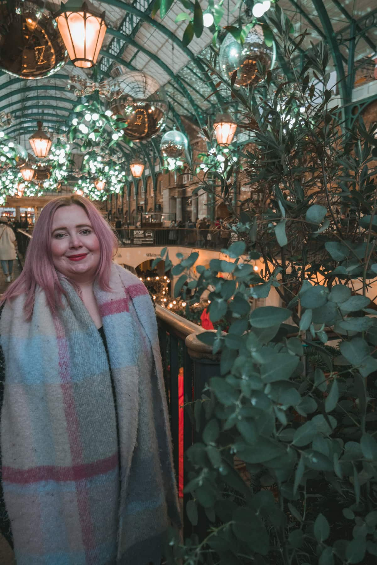 Kat standing in front of the Christmas lights in Covent Garden
