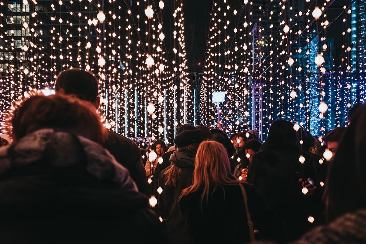People walking inside Winter Lights, Canary Wharf