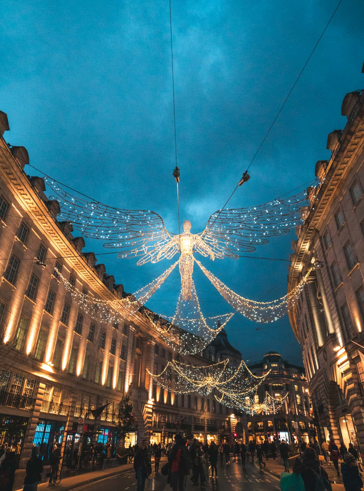 Angel lights on Regents Street with people walking by