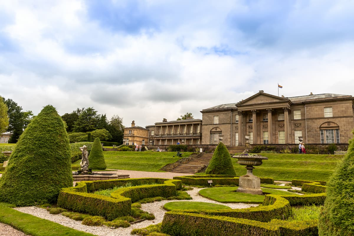 Formal garden and an historic mansion at Tatton Park in England